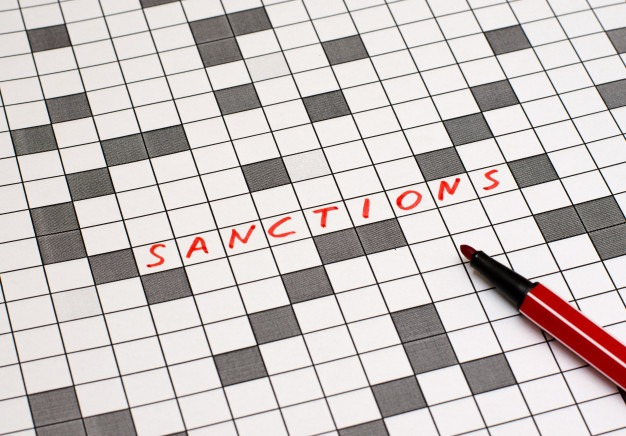 sanctions text crossword red letters 76255 47 - sanctioned in Banking Law