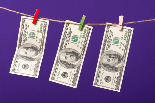 one hundred dollars hanging clothesline with wooden clips blue background 96336 415 - money laundering in Coronavirus Insights